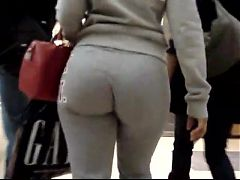 Candid redhead girl big bubble ass in grey pants at store