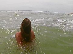 Wading into the ocean TOPLESS