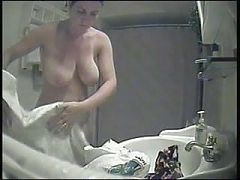 Big boobies voyeured in the shower - milf